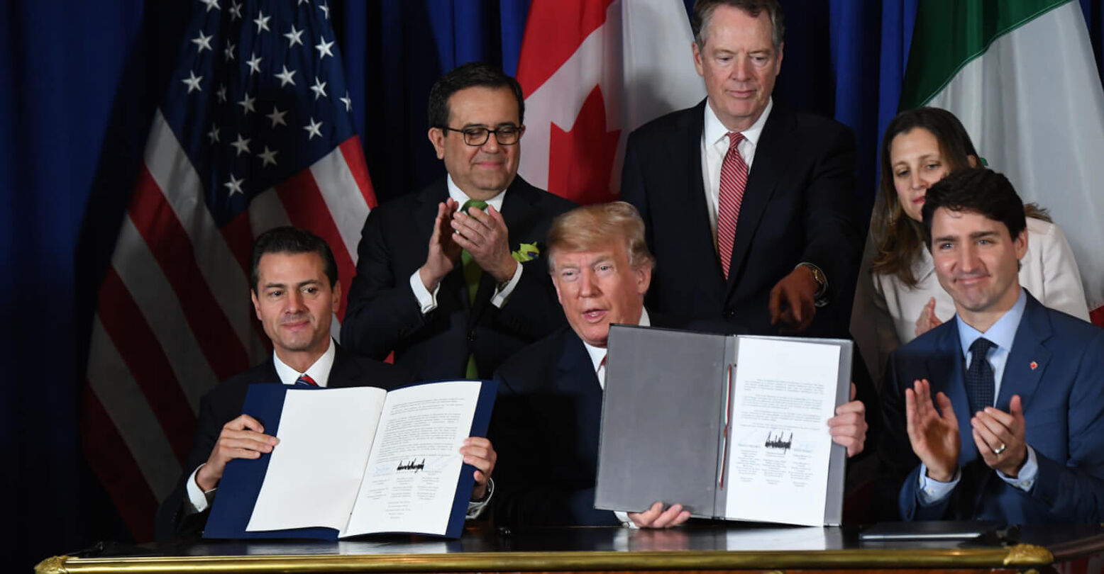 TOPSHOT - Mexico's President Enrique Pena Nieto (L) US President Donald Trump (C) and Canadian Prime Minister Justin Trudeau, are pictured after signing a new free trade agreement in Buenos Aires, on November 30, 2018, on the sidelines of the G20 Leaders' Summit. - The revamped accord, called the US-Mexico-Canada Agreement (USMCA), looks a lot like the one it replaces. But enough has been tweaked for Trump to declare victory on behalf of the US workers he claims were cheated by NAFTA. (Photo by Martin BERNETTI / AFP) (Photo credit should read MARTIN BERNETTI/AFP/Getty Images)