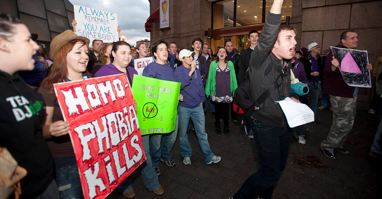 "Protestors march after a three minute Homophobia/Transphobia Kills Die-In protest at South Station in Boston, MA held at the height of rush hour sponsored by ""Join the Impact Massachusetts"" on November 5, 2010. About 300 people took part in the protest. (Photo by Rick Friedman/Corbis via Getty Images)"
